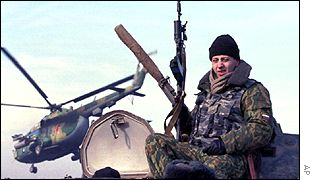 Russian soldier and helicopter