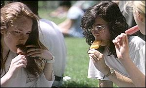 Women eating ice lollies