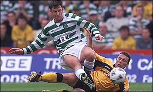Chris Sutton tangles with Livingston's Barry Wilson