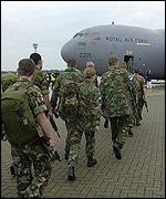 Troops boarding C-117 transport plane