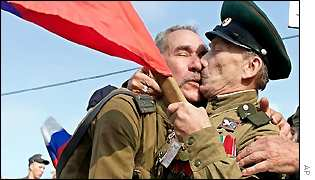 A World War II veteran Lev Kutsevich (right) kisses his friend in celebration