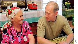 Vladimir Putin speaks with Maria Stepanova while visiting her house in the Karelian village of Yamki