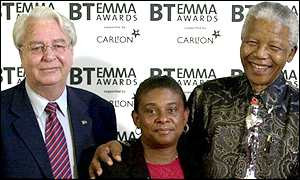 File photo of Donald Woods, left, and Doreen Lawrence, whose son was killed by white youths, granting an award to Nelson Mandela.