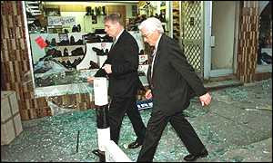 [ image: Northern Ireland's Deputy First Minister Seamus Mallon views the destruction]