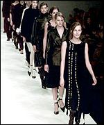 Models dressed in black on the catwalk