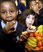 Children enjoying fruit