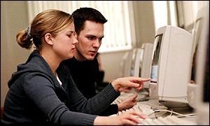 Two people using the internet