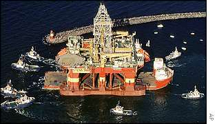 An oil rig being towed into the North Sea