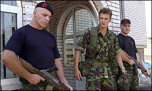 British liaison officer Capt Gareth Hicks (C) meets ethnic Albanian rebels