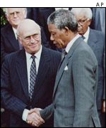 Mandela and de Klerk shake hands