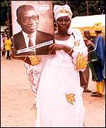 Supporter of ex-president Jawara with his portrait