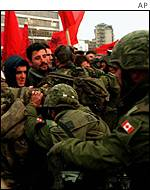 Kfor troops push back ethnic Albanians trying to enter Serb area of Kosovska Mitrovica, February 2000