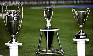 The Super Cup (centre), Champions League trohy (r) and the Uefa Cup