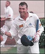 Atherton celebrates his unbeaten 185 against South Africa in 1995