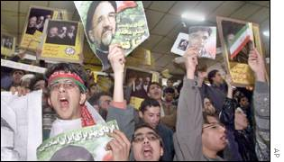 Students demonstrating with posters of President Khatami