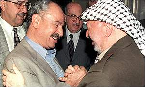 Abu Ali Mustafa shakes hands with Palestinian leader Yasser Arafat in August 1999