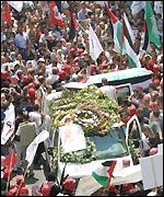 Thousands of mourners attending the funeral of Ali Abu Mustafa