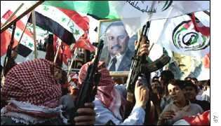 Palestinians hold photos of Mustafa during a demonstration