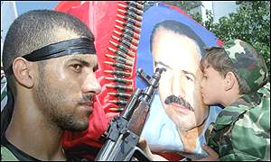 A Palestinian child kisses a portrait of the murdered PFLP leader