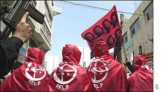 PFLP supporters draped in party's red flag