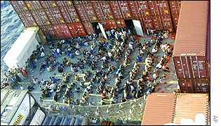 Afghan refugees pack the deck of the Norwegian cargo ship