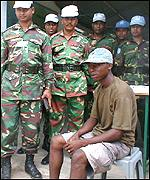 UN peacekeepers supervise the handing in of weapons
