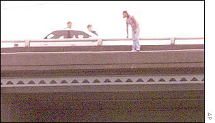 Woman and police on bridge over Seattle's Bridge Canal