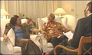 Graca Machel and Nelson Mandela speak to the BBC's Robin Lustig