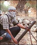 Palestinians prepare to fire mortars