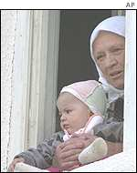 Elderly Albanian woman and child