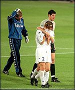 Francesco Totti is inconsolable after France's David Trezeguet scores the golden goal in the Euro 200o final
