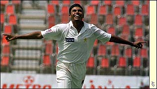 Danish Kaneria celebrates a wicket
