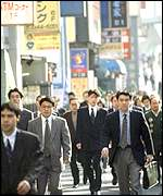 Commuters in Shinjuku, one of Tokyo's main business districts