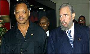 US civil rights activist Jesse Jackson, left, and Cuban President Fidel Castro, arrive for the conference