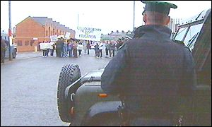 RUC officers watch a protest in June this year at the Holy Cross school