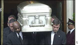 Pallbearers carry the coffin from Frank E Campbell Funeral Home