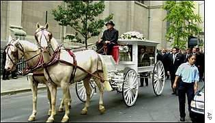 Horse drawn hearse bearing Aaliyah's remains