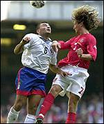 Robbie Savage enjoys a hair-raising moment against Armenia