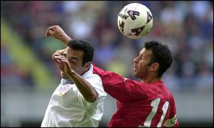 Ryan Giggs tangles with Armenia's Arkadi Dokhoyan