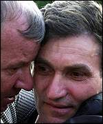 Unidentified Macedonian hostages embrace after being freed in Tetovo