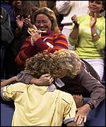Kuerten is congratulated by his mother