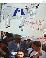 Palestinian banner with Sharon pictured as a donkey