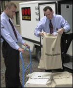Employees of a security company transfer bags containing new Euro