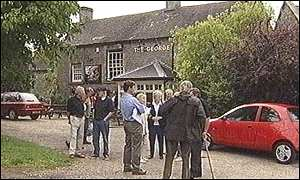 Villagers outside the pub in Alstonefield