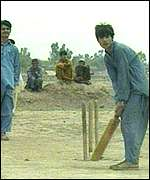 Afghan refugees playing cricket