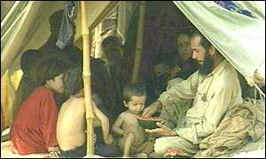 Afghan refugees in Jalozai tent