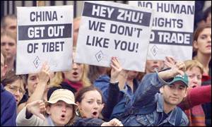 Irish protesters with anti-China banners