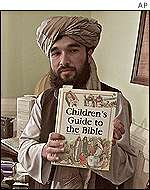 Taleban foreign ministry official holds children's bible
