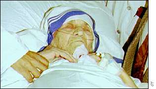 Mother Teresa in hospital bed