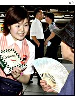 Japanese sales assistant shows a customer a product